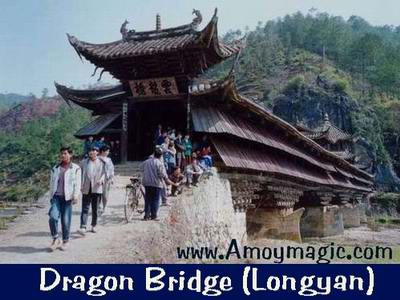 Dragon Bridge--elegant old Chinese wooden covered bridge in Longyan, West Fujian; photo courtesy of Mr. Hu Shaogang (Babushka), of Changting's Public Relations Department.  Amoy Magic--Guide to Xiamen and Fujian, http://www.amoymagic.com