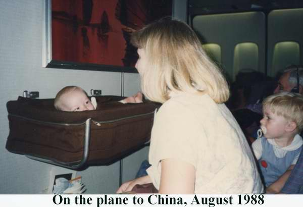 Sue Brown on plane on way to Xiamen China with Shannon Brown 2 years old Matthew Brown 6 months old August 1988